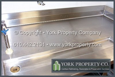 Repairing and refurbishing scratched and damaged stainless steel commercial sink and counter top.