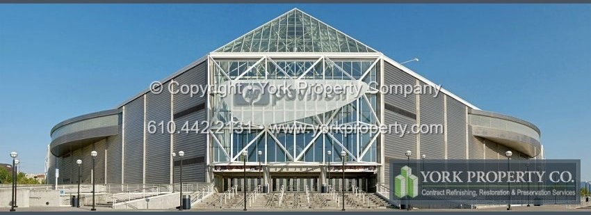 Silicone stained stainless steel spandrel panel cleaning, washing acid etched stainless steel building panel refinishing.