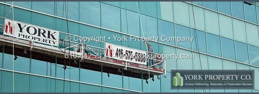 Cleaning faded and oxidized exterior building facade painted aluminum panels, refurbishing pitted painted aluminum window mullions, restoring chalked painted aluminum storefront window frames and repairing stained entrance doors.