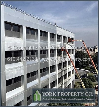 Cleaning dirty anodized aluminum curtain wall clad panels.