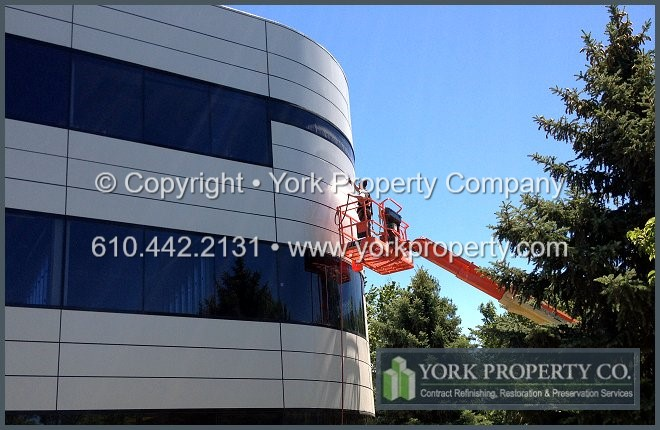 Anodized aluminum building facade cleaning and refinishing.